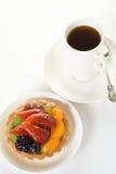 Bolo e chávena de café Fotografia de Stock