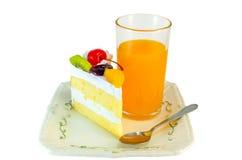 Bolo e suco de laranja Imagem de Stock