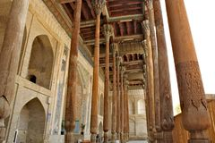 Bolo Haouz Mosque in Bukhara. Bolo Haouz Mosque built in 1712; on the UNESCO World Heritage Site list; served as a Friday mosque. Thin columns made of painted royalty free stock photography
