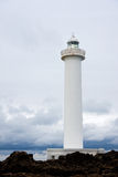 Bolo Point. Lighthouse with cloudy sky behind it in Bolo Point, Okinawa, Japan Royalty Free Stock Photo