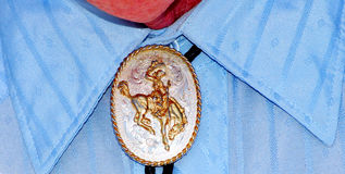 Bolo tie. Cowboy wearing a bolo string tie under his dress shirt Royalty Free Stock Photos