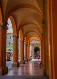 Bologna arcades street passage. The city of Bologna in northern Italy has numerous typical arcades along the majority of it's streets allowing for protection Royalty Free Stock Images