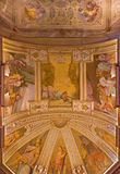 Bologna - The ceiling fresco in chapel of the sacristy in baroque church San Michele in Bosco with the Old Testaments scenes. Stock Photography