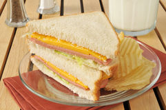 Bologna and cheese sandwich with milk Stock Images