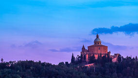 The Bologna Church. San Luca basilica church on Bologna hill, in a colorful sunset. pink and blue. in Italy Royalty Free Stock Photography