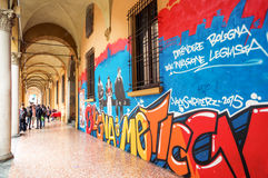 Bologna a city in Red color. Bologna, Italy - May 5, 2016:  Students under the arcades of the University district Stock Photo