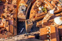 Bologna cityscape view. Aerial cityscape view from the tower on Bologna old town with Garisenda tower and roman catholic church Royalty Free Stock Image