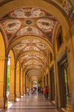 Bologna decorated arcades street passage. The city of Bologna in northern Italy has numerous beautifully decorated typical arcades along the majority of it's Stock Photo