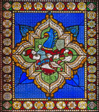 Bologna - der symbolische Drache von der Wappenkunde auf Fensterscheibe der Kirche San Giovanni in Monte Stockbilder