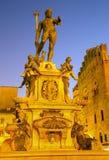 Bologna - Fontana di Nettuno or Neptune fountain on Piazza Maggiore square. In dusk royalty free stock photography