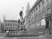 Bologna - Fontana di Nettuno or Neptune fountain on Piazza Maggiore square and Palazzo Comunale. In fogy morning royalty free stock image