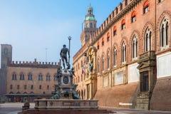Bologna - Fontana di Nettuno or Neptune fountain on Piazza Maggiore square and Palazzo Comunale. In fogy morning stock image