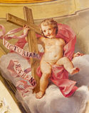 Bologna - Fresco of angel with the cross in side cupola of Dom - Saint Peters baroque church by U. Bigari (1692 - 1776). Royalty Free Stock Photo