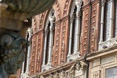 Bologna, Historic palace, facade. Bologna (Emilia-Romagna, Italy) Neptune's fountain (Gianbologna, 1565) and historic palace facade royalty free stock photo