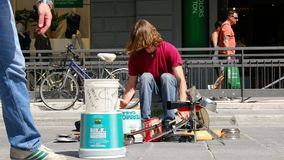 Street drummer money tips stock video footage