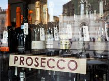 Italian prosecco wine bottles in Bologna. BOLOGNA, ITALY - CIRCA SEPTEMBER 2017: Italian prosecco wine bottles in a shop window royalty free stock images