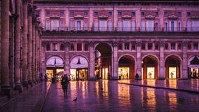 BOLOGNA, ITALY - 15 FEBRUARY, 2016: An unidentified woman walks in Piazza Maggiore, Bologna, Italy. BOLOGNA, ITALY - 15 FEBRUARY, 2016: An unidentified woman Royalty Free Stock Images