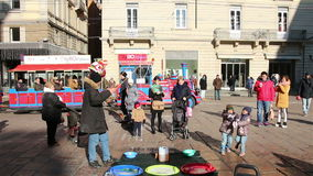 Bologna, Italy - January 1, 2015 Children Amazed By Huge Soap Bubbles On The Street in Bologna, Italy. stock video footage