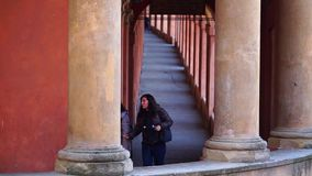 Bologna, Italy 07 January 2019: two women are arriving from San luca under the famous portico that connect the town to the churc stock footage