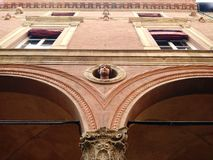 Sculpture heads on a palace facade at Bologna, Italy royalty free stock photos