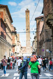 Bologna. Italy-May 17,2014:view of the Asinelli tower and the many tourist that stroll in the city from the Ugo Bassi street in the centre of  during a sunny Stock Image