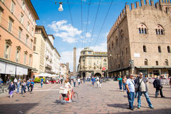 Bologna. Italy-May 17,2014:view of the famous twin towers in the centre of  from the piazza Maggiore during a sunny day.People and tourist walk about the city Stock Photo