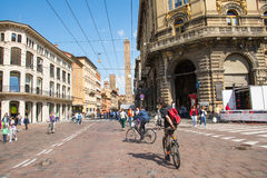 Bologna. Italy-May 17,2014:view of the famous twin towers in the centre of  from the piazza Maggiore during a sunny day.People and tourist walk about the city Royalty Free Stock Photography