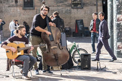Bologna, Italy, October 15 2016 - A contrabass street performer Royalty Free Stock Photos
