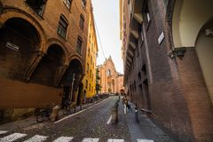 BOLOGNA, ITALY - October, 2017: Old street view Bologna city, Italy. Cobble stone street with bollards. Renaissance buildings Stock Photo