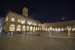 Bologna, Italy, people in piazza Maggiore, central square of the city. Bologna, Italy, people in piazza Maggiore, city central square by night royalty free stock image