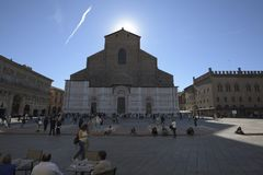 Bologna, Italy, people in piazza Maggiore, central square of the city. Bologna, Italy, people in piazza Maggiore, city central square, Basilica of saint Petronio royalty free stock photo