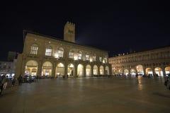 Bologna, Italy, people in piazza Maggiore, central square of the city. Bologna, Italy, people in piazza Maggiore, city central square by night stock photos