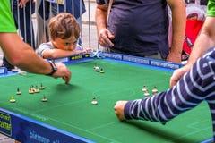 Bologna, Italy, 18 September 2016: A child focusing on a Subbute. O game Stock Photography