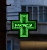 Bologna / Italy - September 22, 2019: European green cross pharmacy store sign: Farmacia, pharmacy sign.