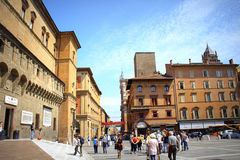 Bologna Italy. Tourists sightseeing at Piazza Nattuno in Bologna city center in front of Biblioteca Salaborsa bulding, Italy Royalty Free Stock Photos