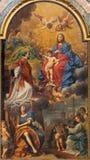 Bologna - Madonna i härligheten med sten Ignace, änglar och helgon vid D Creti (1736) barockkyrka i för Dom - St Peters royaltyfria foton