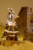 Bologna main square and Neptune fountain after the heavy snowfall of 2012. BOLOGNA,IT - FEBRUARY 1, 2012 - Bologna main square with Neptune fountain after the royalty free stock photo