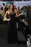 Black car and show girl in Bologna Motor Show Stock Photography