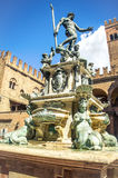Bologna neptune fountain gush statues reinassence emilia romagna monuments. Bologna, Italy, April 25 2016: The tall Neptune fountain during a sunny day. Re Enzo Stock Photography