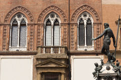 Bologna, Neptune's bronze statue and palace. Bologna (Emilia-Romagna, Italy) Neptune's bronze statue (Gianbologna, 1565) and historic palace facade Stock Photography