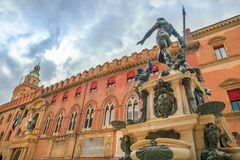 Bologna Nettuno palace. Nettuno 1567 bronze statue and fountain in front of Accursio palace, built in 1290, in Piazza Maggiore square, the seat of the municipal stock photography