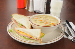 Bologna sandwich with chicken soup Stock Images