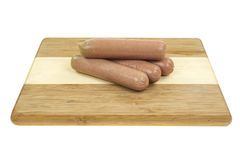 Bologna sausages on wood cutting board Royalty Free Stock Image