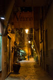 Bologna small street at night. BOLOGNA, ITALY - NOVEMBER 2015: Small street in historical center of Bologna, Italy Royalty Free Stock Photo