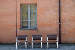 Bologna, three chairs under a window Royalty Free Stock Photos