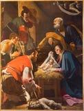 Bologna - tillbedjan av herdemålarfärgen från kapell av Kristi födelse av Giacomo Cavedoni i Saint Paul eller Chiesa di San Pao Arkivbilder