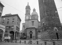 Bologna - Torre Asinelli and Torre Garisenda towers and church of st. Bartolomeo e Gaetano. Royalty Free Stock Image