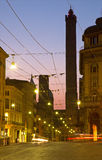 Bologna - Torre Asinelli and Torre Garisenda towers at dusk from Via Rizolli. Royalty Free Stock Photo