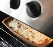 Traditional Bolognese lasagna in cooking royalty free stock image