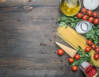 Bolognese pasta cooking concept, raw minced meat, tomato paste, cherry tomatoes, pasta, parmesan, onions, garlic, herbs herbs, royalty free stock photography